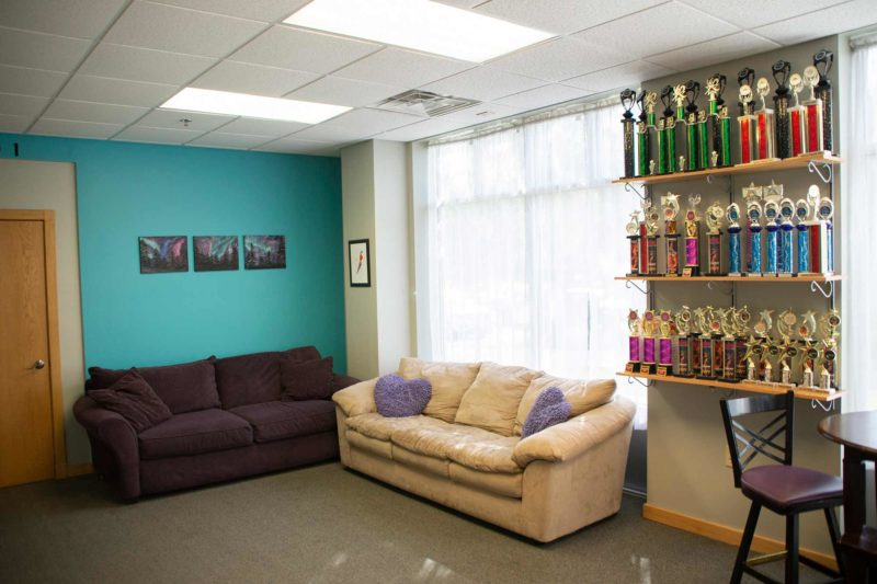 Ultimate Leap Dance Center Waiting Area with sofa and trophies